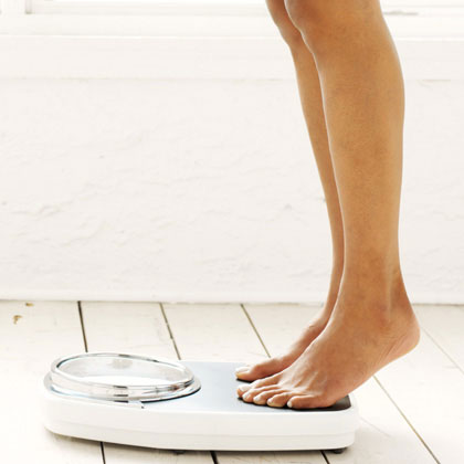 woman-weighing-herself