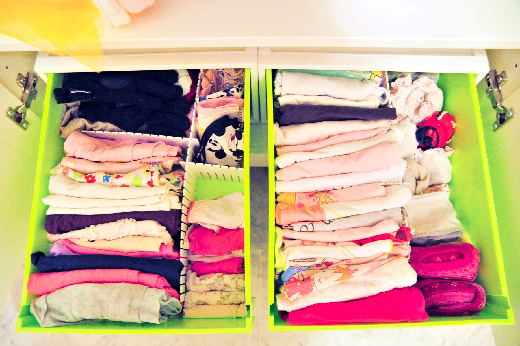 Doubling the space in your kids' itsy bitsy wardrobe